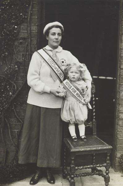 Rose Lamartine Yates with Paul - both wearing Votes for Women sashes
