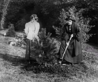 Rose Lamartine Yates planting a tree with Annie Kenney looking on, taken by Col Linley Blathwayt of Eagle House, 1909