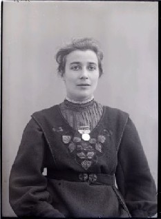 Rose Lamartine Yates with a Votes for Women ribbon pinned to her dress, taken by Col Linley Blathwayt of Eagle House, 1909