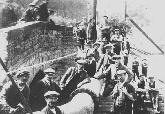 Workmen installing a new water main in 1915 alongside the 1788 stone Wepre Bridge